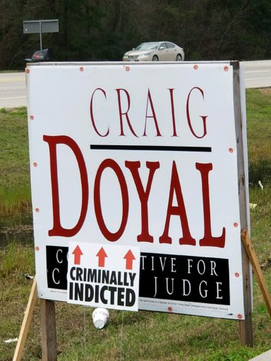 """Criminally Indicted"" signs appear across Montgomery County on Doyal, Riley political signs"