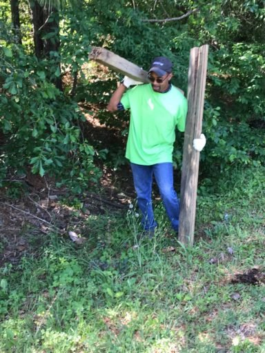 """After promising to cook for River Plantation Trash Pickup Day, Montgomery County Commissioner Riley a """"no-show"""" while challenger Parker leads trash pickup team"""